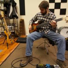 Jon McMillan laying bass
